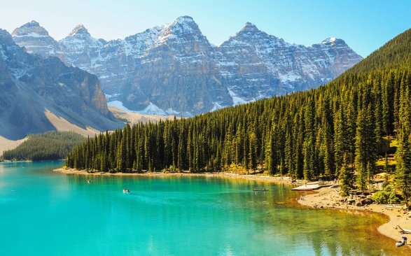 Rocky Mountains reflecting in Lake Moraine, Alberta, Canada.